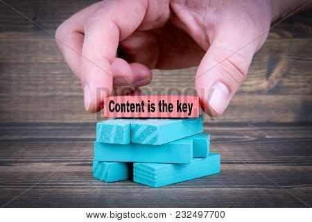 Content Is The Key. Business Concept With Colorful Wooden Blocks.