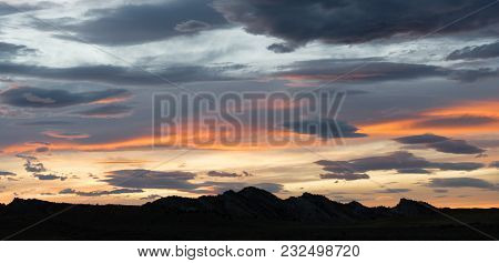 Sunset Over Yellowstone Western Hill Country Grey Clouds Orange Sections