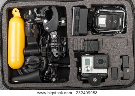 Action Camera With Accessories In The Bag.