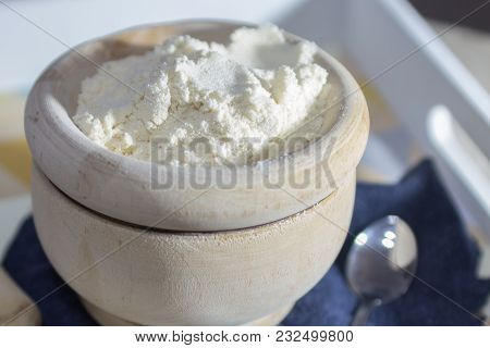 Natural Flours In Wooden Bowl With Mortar