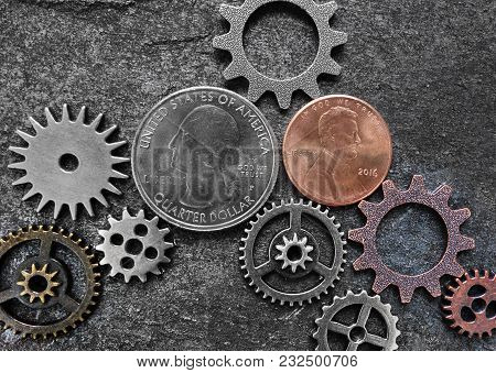 Coins And Metal Gears On Dark Textured Background