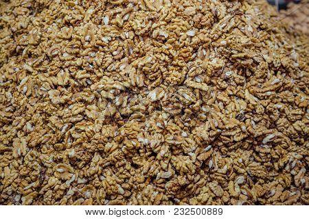 Big Shelled Walnuts Pile. Walnut Kernel Background.