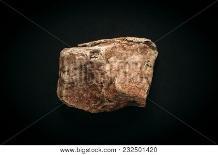 Macro Photo Of Natural Mineral Stone Orange Or Pink Wild Marble Isolated On Black Background