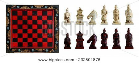 Carved Chess Pieces In Chinese Style And Chessboard. Isolated, White Background.