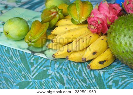 Flat Lay View Of Bunch Of Bananas For Sale In Rarotonga Market, Cook Islands. The High Content Of Po
