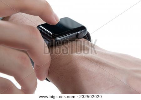 Smart watch being worn on a boy's left wrist isolated on white background.