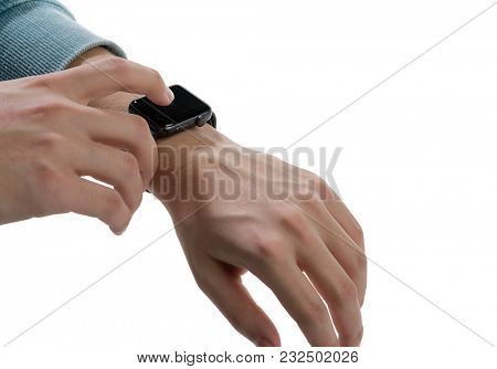 Young man checking his daily activities using his wristwatch isolated on white background.