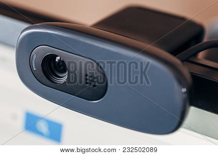 Modern Web Camera On Computer Monitor. Digital Device For Online Conference, Broadcasting And Video