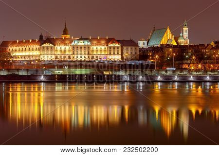View Of The City Embankment At Night With A Reflection In The River. Warsaw. Poland.