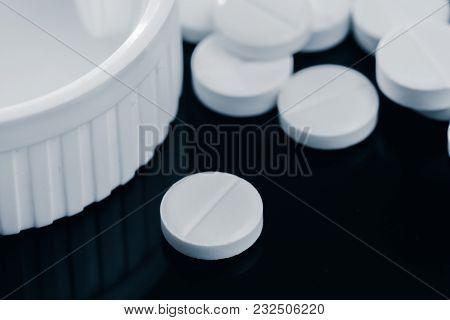 Heap Of White Tablets Medicine Lying Beside Of Plastic Bottle. Pills And Bottles Are White. Isolated