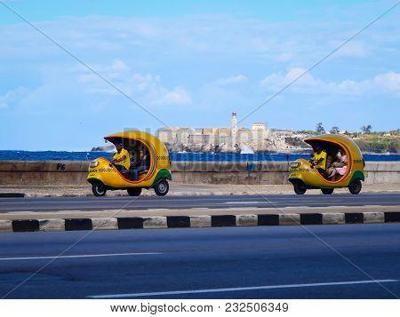 Havana, Cuba, 02.23.2017: Taxi Motorbikes Driving Along The Malecon.