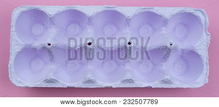 Banner Stand For Eggs Purple On A Pink Background. Surrealism. Flat Lay Top View