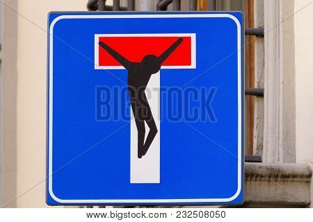 Road sign with a crucified man, street art, metropolitan art poster