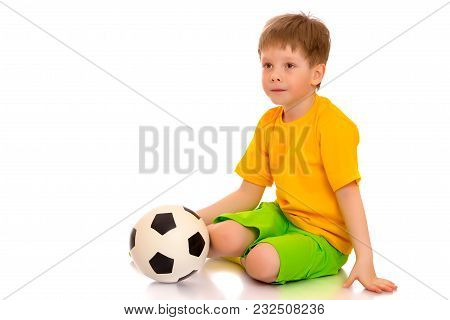 A Sporty Little Boy Is Playing With A Soccer Ball. Concept Of A Healthy Lifestyle, Sport And Fitness