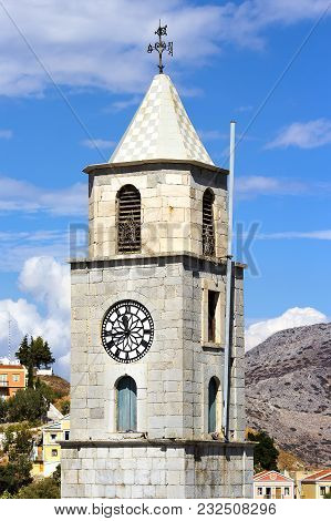 Clock Tower On The Docks Of Symi Island, Dodecanesse, Greece