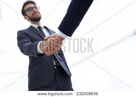 Success concept in business - handshake of partners