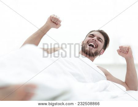 happy man waking up in the morning