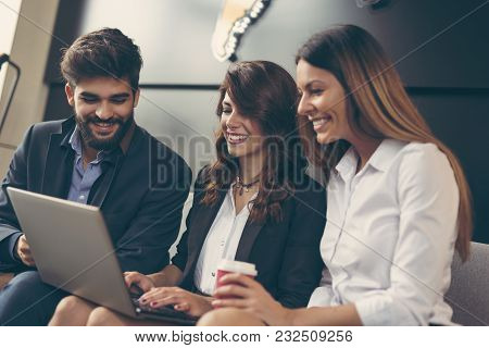 Business People Discussing Work Related Matters And Working In A Modern Office Building. Focus On Th