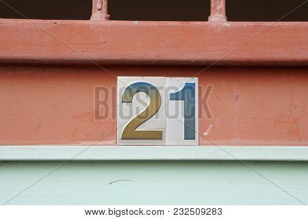 House Number 21 Alphabet On Old Metal Fence