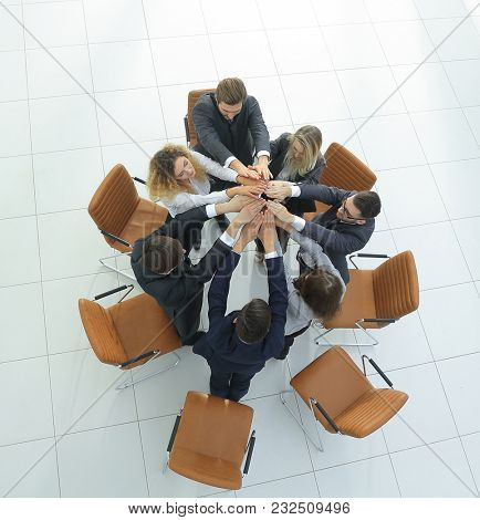 view from the top. business team joining their palms