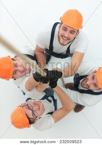 view from the top.a group of workers pulling a rope