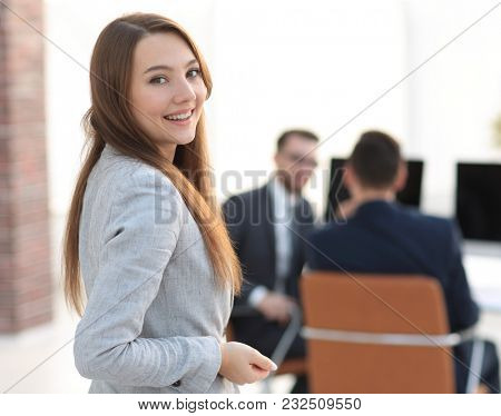 smiling employee on the background of the office.