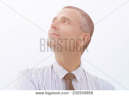 confident businessman looking into the future