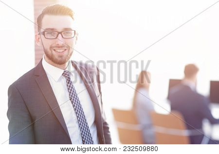 successful businessman on background of office