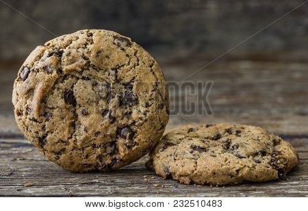 Two Freshly Baked Chocolate Cookies On Rustic Wooden Table. Sweet Biscuits. Homemade Pastry.