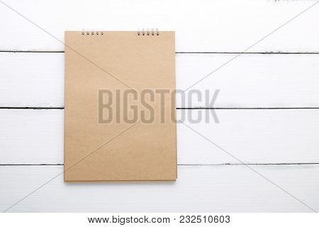 Blank Recycle Paper Notebook On Vintage White Wood Background With Copy Space For Text
