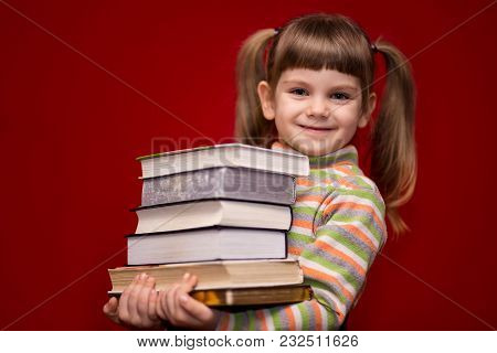 Little Girl Hold Many Book Isolated On Red. Concept Of Knowledge Or School. Book Lover.