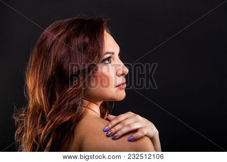 Pretty Young Girl On Black Background In Studio
