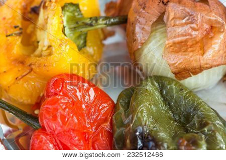 Hot Grilled Seasoned Vegetables Red Yellow Green Capsicums Onions In Tint Foil. Healthy Street Food