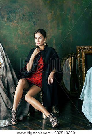 beauty rich brunette woman in luxury interior near empty frames, wearing fashion clothes, lifestyle people concept close up poster
