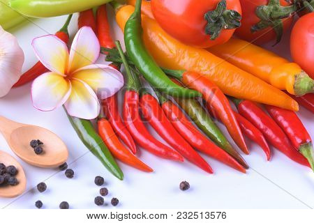 Asian Ingredients Food Fresh Spices Vegetable (tomato, Chilli, Garlic, Pepper, Plumeria) Close Up.
