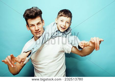 Young Pretty Man Model With Little Cute Son Playing Together, Lifestyle Modern People Concept, Famil