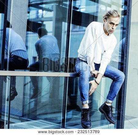 Young Modern Hipster Guy At New Building University Blond Fashion Hairstyle Having Fun, Lifestyle Pe
