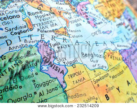 Country Of Tunisia And Mediterranean Sea Isolated Focus Macro Shot On Globe Map For Travel Blogs, So