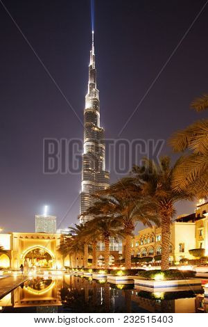 DUBAI, UAE - FEBRUARY 2018: The entrance to the Palace Hotel in Dubai with Burj Khalifa in the background. The Burj Khalifa is the tallest structure in the world housing hotels and apartments