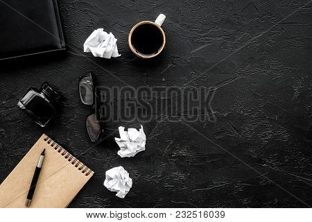 Retro And Modern Writer Desktop With Cup Of Coffee, Notebook And Ink On Black Table Background Top V