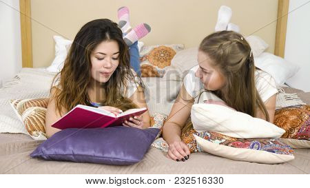 Friendship Bff. Fun Leisure Pastime. Communication Conversation. Girlfriends Lying On The Bed Chatti
