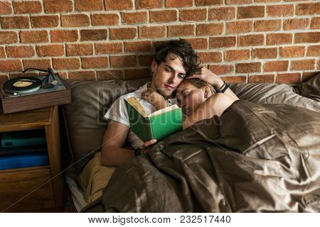 Caucasian couple spending time together in bed