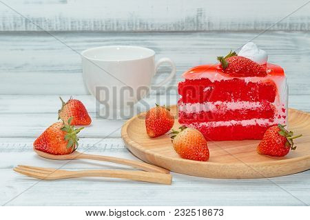 Strawberries Cake And Cream With Tea Cup On Wooden Background.