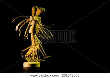 Overlapping Images Of Golden Wooden Doll Simulating Walking And Running. Concept Of The Financial Pr