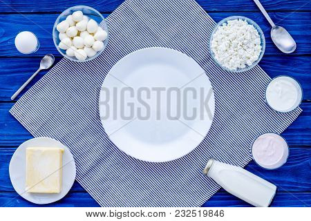 Breakfast On Farm With Dairy Products. Milk, Cottage, Cheese, Yougurt On Blue Wooden Table Top View