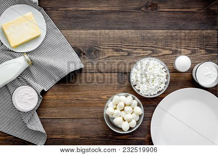 Breakfast On Farm With Dairy Products. Milk, Cottage, Cheese, Yougurt On Dark Wooden Table Top View