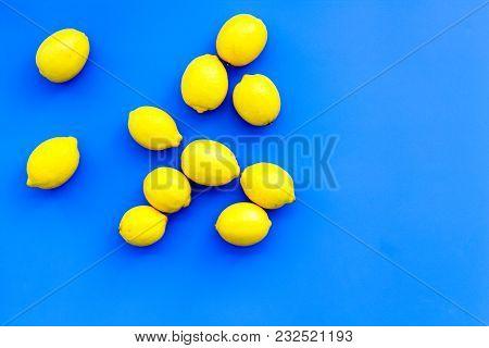 Ripe Lemon Fruit Backround On Blue Table Top View.