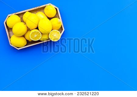 Ripe Lemon Fruit In Tray On Blue Background Top View.