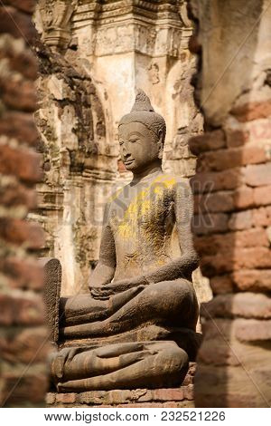 Beautiful Rock Buddha Image In Ruined Historical Public Park Of Thailand