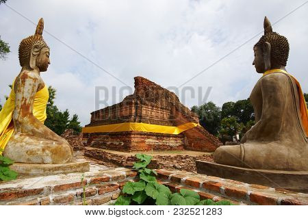 Beautiful Rock Buddha Image In Ruined Historical Buddhist Temple  Of Thailand